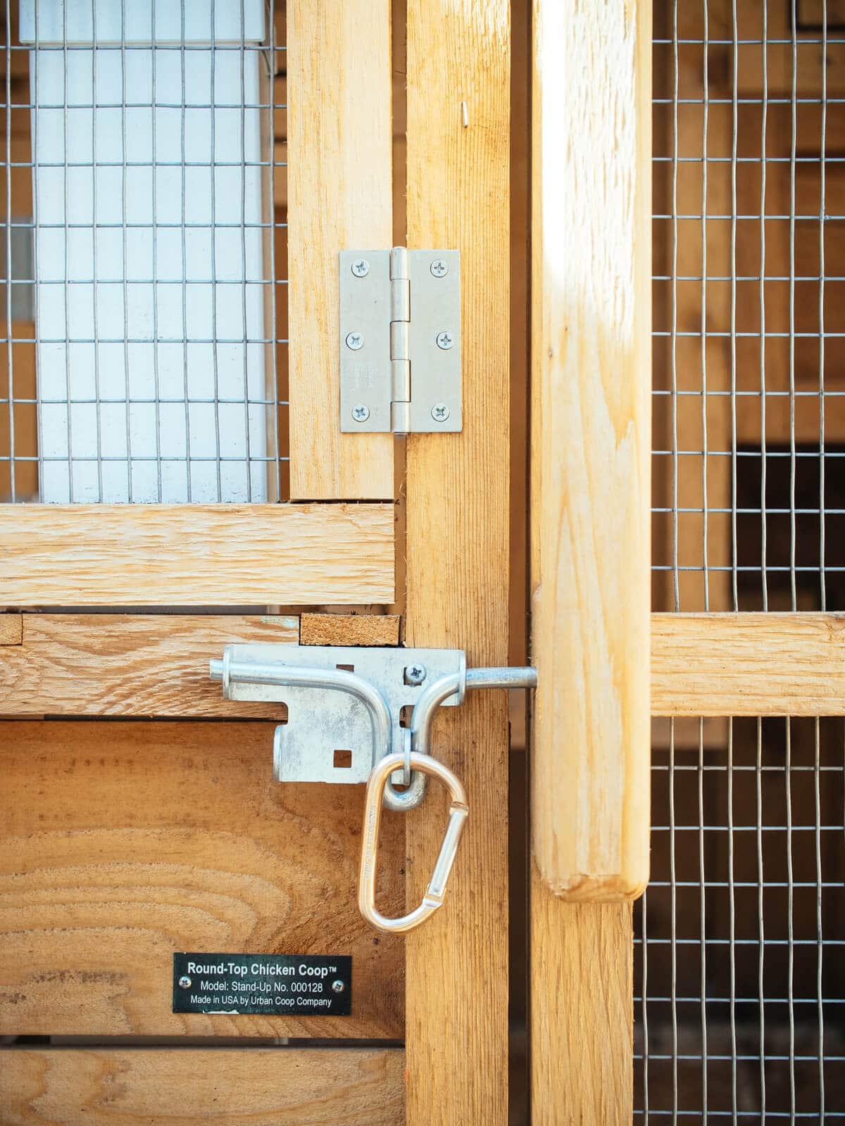 Slide bolt secured with carabiner