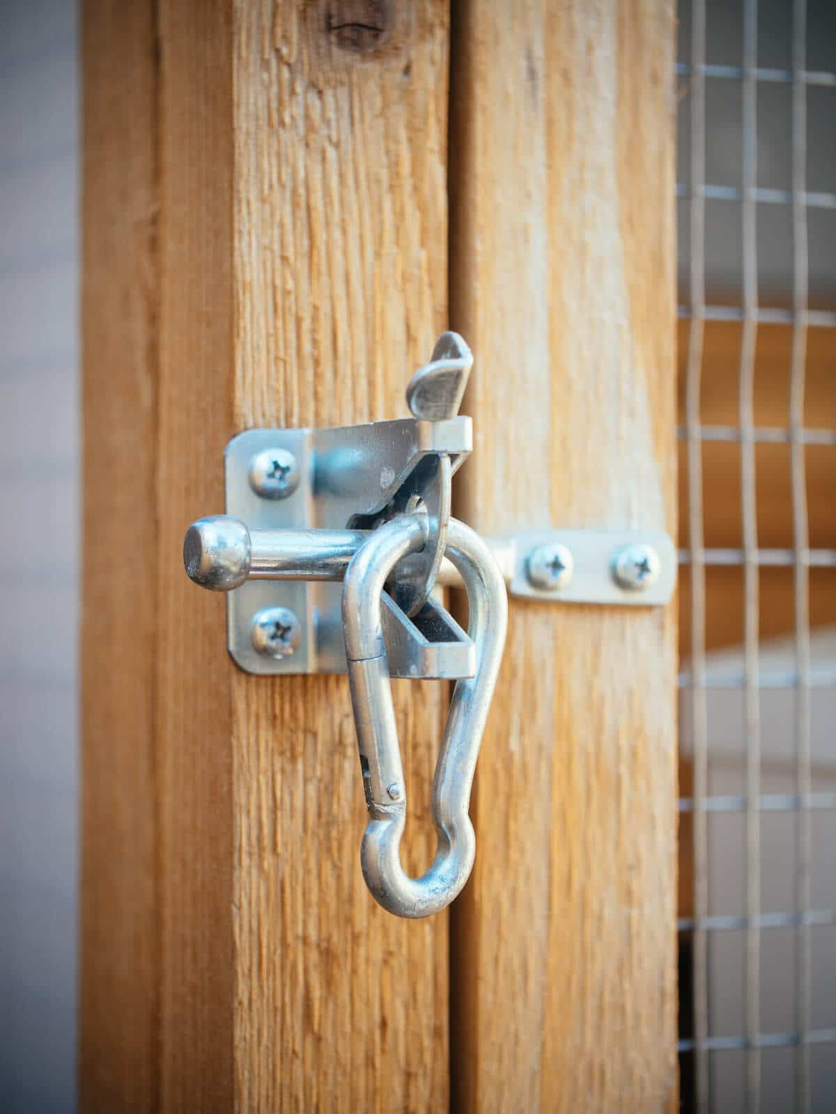 Gate latch secured with spring link