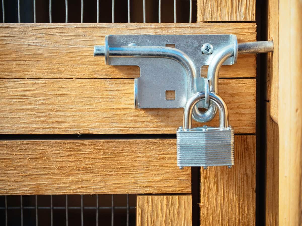 Slide bolt secured with padlock