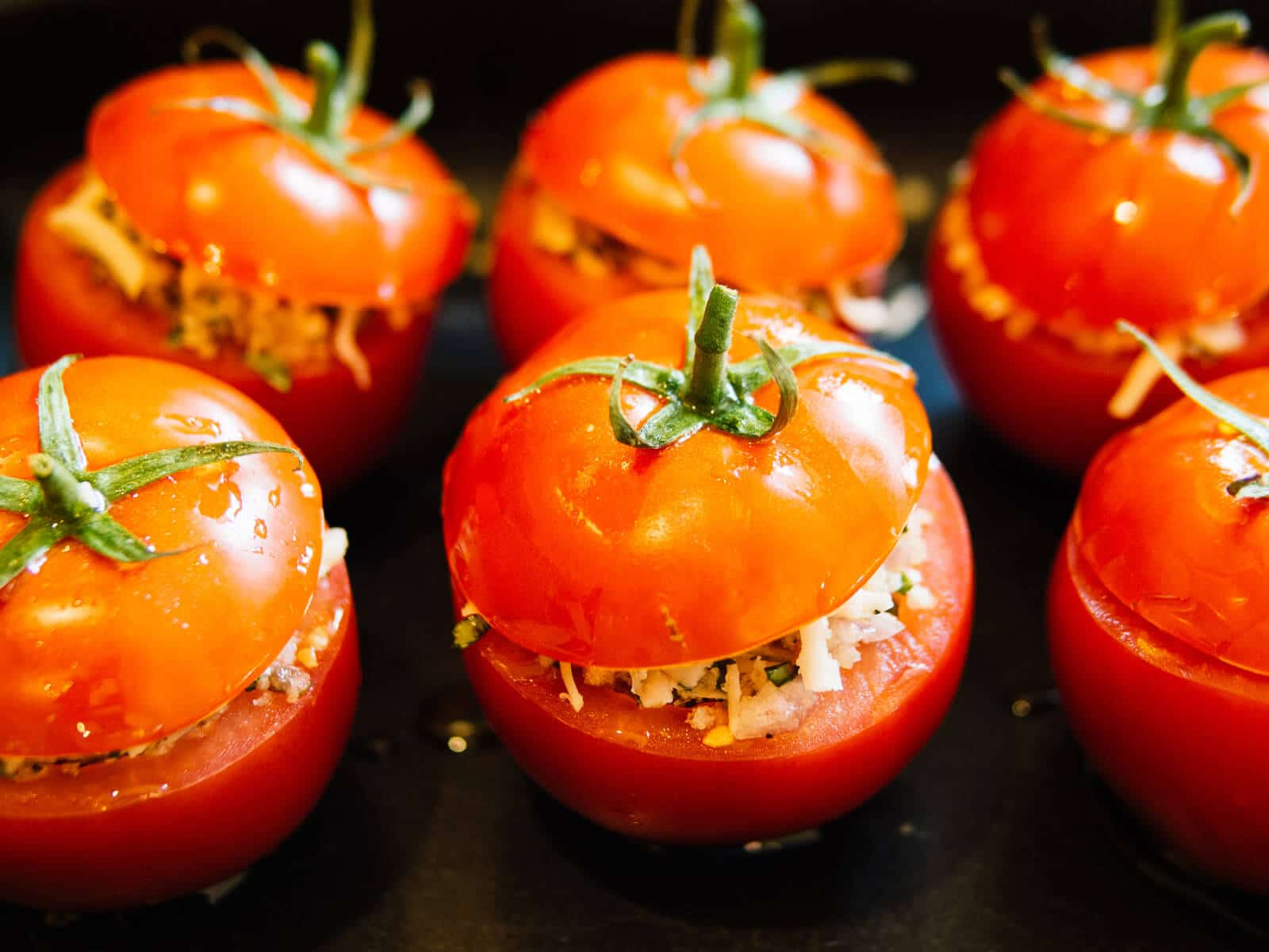 Plank-grilled stuffed tomatoes