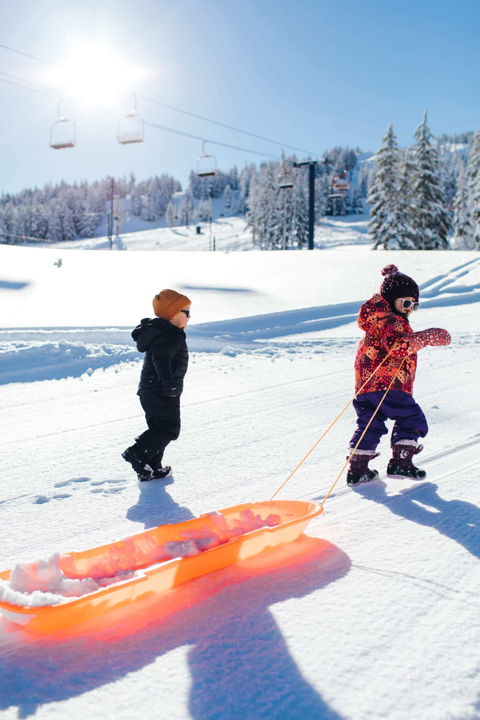 Toddlers on the sled hill
