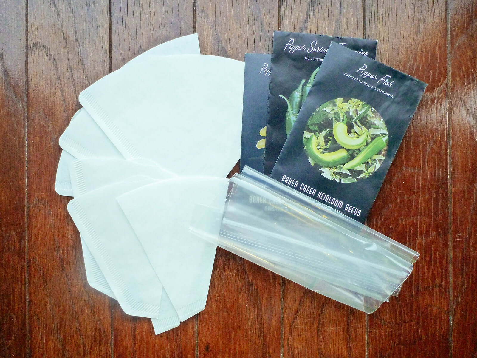 Gather your supplies for starting seeds in coffee filters