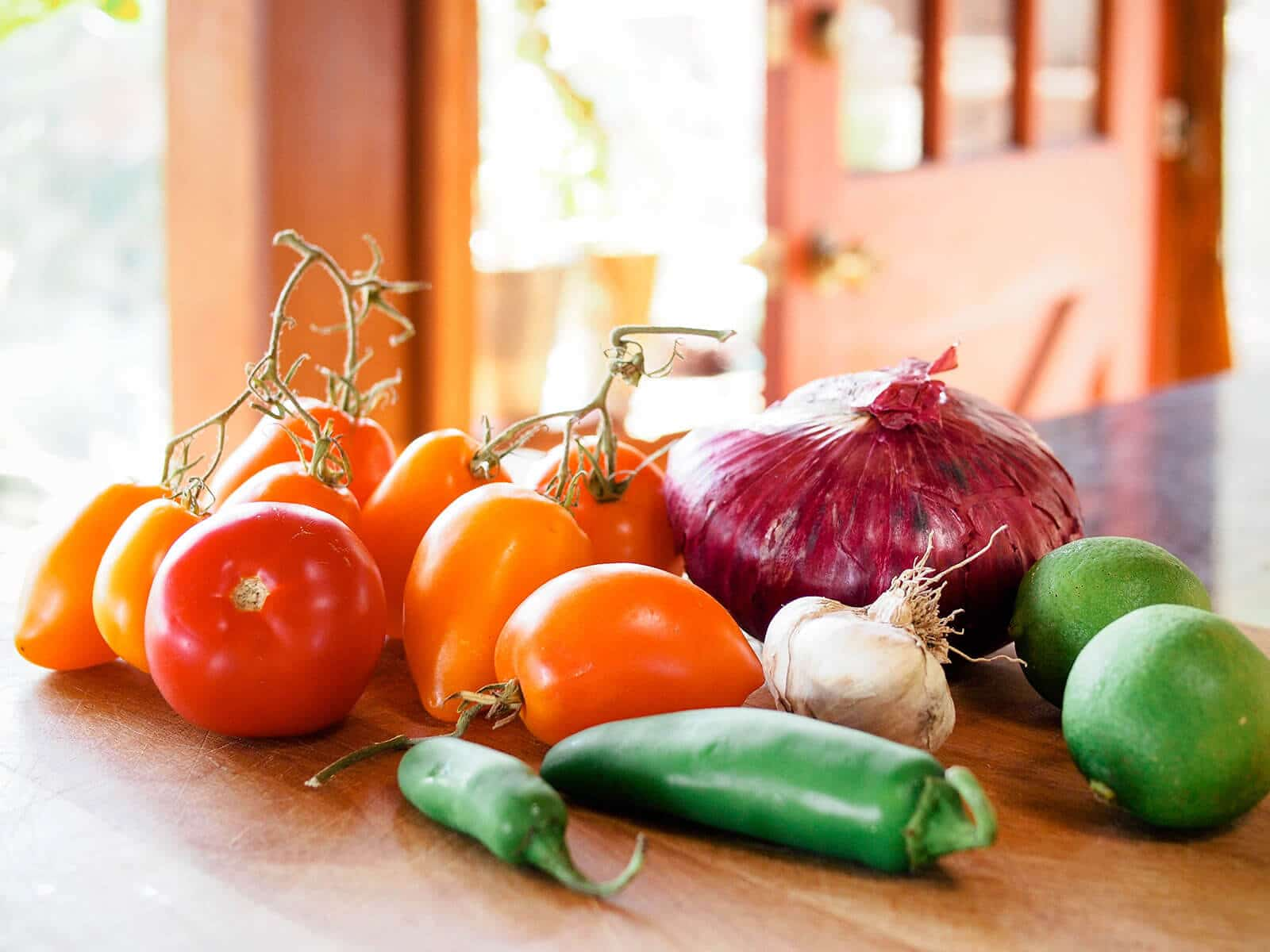Salsa ingredients sitting on a cutting board