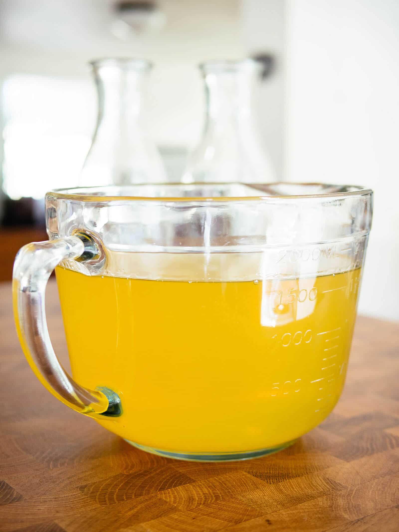 Bowl of bright yellow lemon-infused grain alcohol