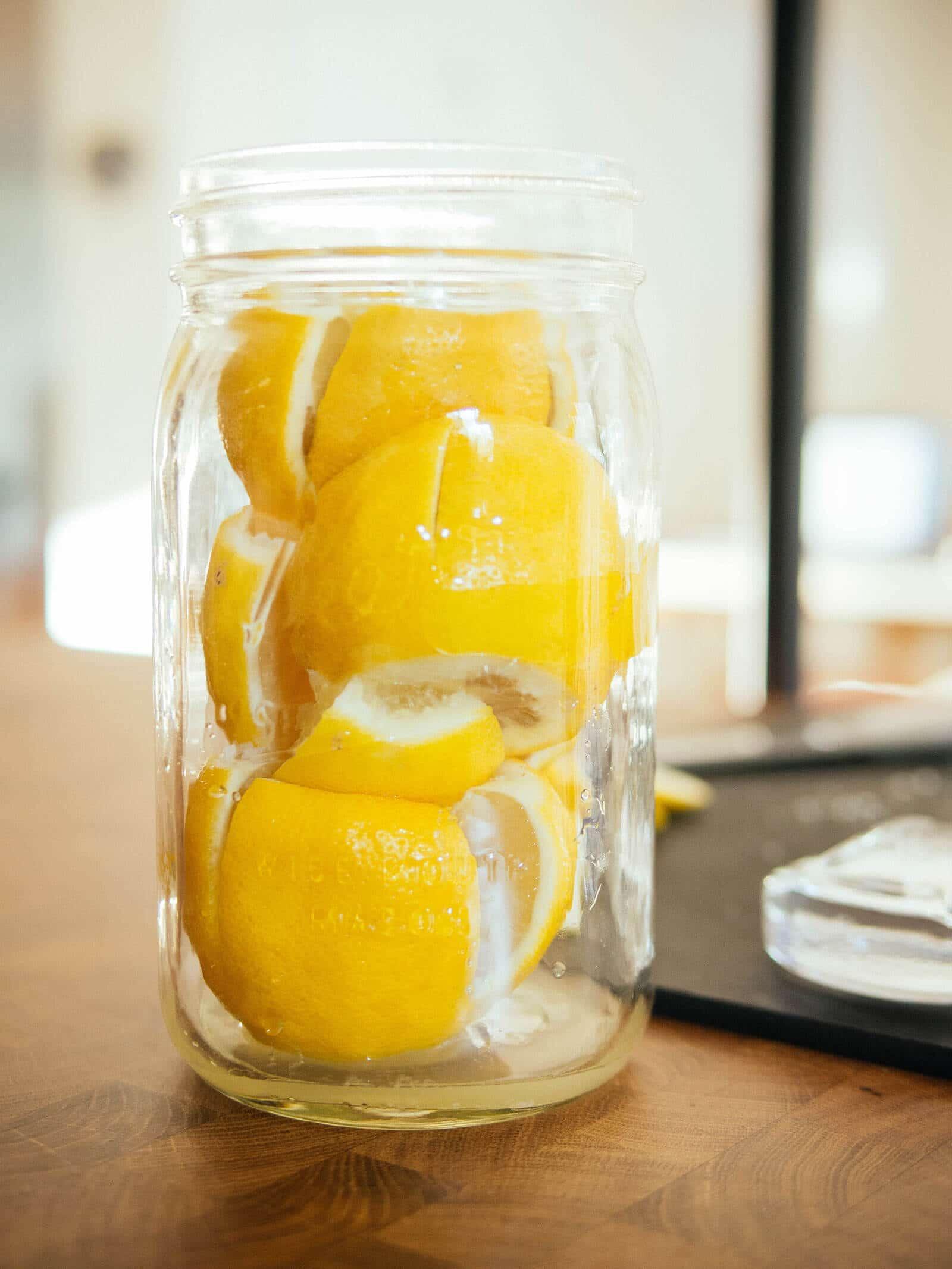 Salted lemons packed into an empty mason jar